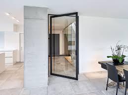 glass and aluminium offset axis pivot door skd75 black by anyway doors