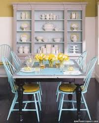 dining room with dark table painted chairs