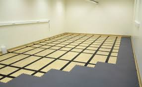 description mototile interlocking garage floor tiles are uk manufactured from semi rigid injection moulded pvc in solid colours and in a coin top or