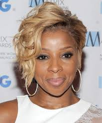 mary j blige short wavy formal hairstyle um blonde