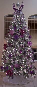Christmas Tree Decoration Ideas: Natural tree with decorations of silver &  shades of purple