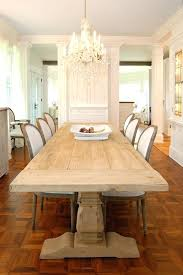 dining room table chandelier narrow dining room tables tall back chairs hardwood floors glass panels chandelier white walls cabinets shabby how high above