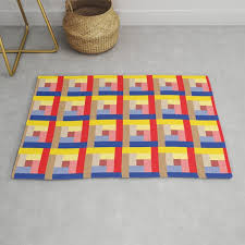 sundial yellow red blue brown rug