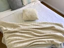 matching cream throw blanket and cushion
