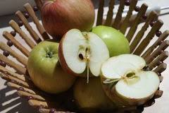 green and red apples in basket. beautiful natural juicy green and red apples in wooden basket on the nature stock photo