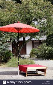 japanese outdoor furniture. Red Umbrella In Garden For Green Tea Ceremony, Japanese Style Outdoor Furniture