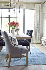 modern dining room rug. Dumont Dining Table Black Tufted Chairs Vintage Inspired Blue Rug Transitonal Modern Room -4 S