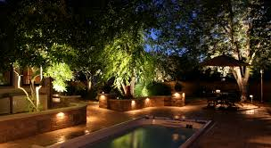 delightful kichler landscape lighting with decorative outdoor home design ideas swimming pool night lights brick wall