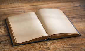 open blank pages of old book on wood background