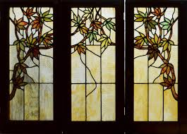 fl antique american stained glass set of cabinet doors depicting woodbine vines and leaves in their wood grained frames each window measures 17 x