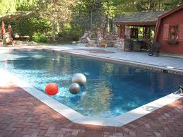 amazing outdoor pool with kool deck and covered patio excerpt