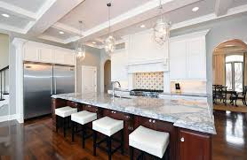 Traditional Kitchen With Large Island And Gray Marble Countertops