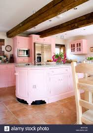 Country Kitchen Floors Pastel Pink Fitted Units And Beamed Ceiling In Country Kitchen