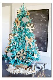 Rustic Turquoise Christmas Tree. See 15 Amazing Christmas Trees on  www.prettymyparty.com