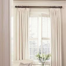 this rug combining plantation shutters with curtains privacy cosiness warmth