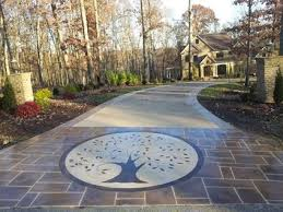 concrete driveway cost how much to