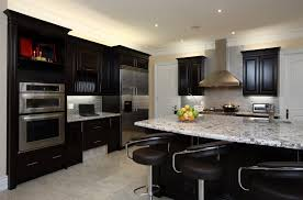 kitchens with dark cabinets. Interesting Cabinets Kitchen Is Great Example Of High Contrast Between Dark Toned Wood Cabinetry  And Light Marble Surfaces And Kitchens With Dark Cabinets C