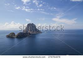 view of es vedra beautiful beach of ibiza the typical view of the rock