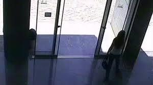 girl walks into sliding glass door