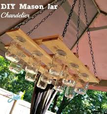 check out here another simple but graceful mason jar chandelier here that is having the frame made of custom wood planks here the custom bigger holes or