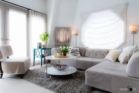 delightful small living room with modern sectional sofa and upholstered chair along with round table and