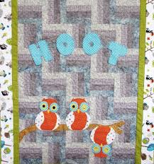 8 Baby Boy Quilt Patterns That'll Bring You Joy & hoot quilt featuring cute, patterned owls Adamdwight.com