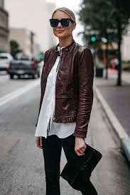blonde woman wearing ann taylor luxewear moto leather jacket white shirt black skinny jeans black clutch
