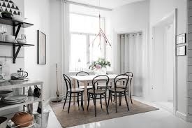 dining room lighting design. Rather Than Overwhelm The Space, These Light And Airy Chairs In Natural Wood Blend Flawlessly Into Rest Of Look Due To Their Breezy Makeup. Dining Room Lighting Design A