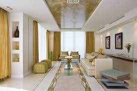 decorating idea family room. Long Narrow Family Room Layout With Gold Interior Design Trend And Using High Quality Furniture Also Beautiful Yellow Curtains Decorating Idea