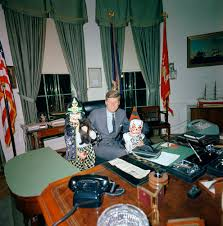 jfk oval office. president john f kennedy visits with his children caroline left holding a cat and jr in the oval office are jfk