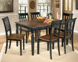ashley dining tables signature design by 7 piece rectangular table set item number round glass
