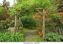 full size of wooden archway entrance into garden with trees orange flowered arches gates outstanding
