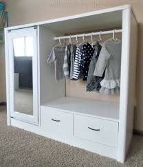 i turned an old entertainment center into a chic and adorable armoire for my daughter