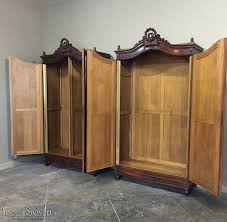french antique hand carved armoire. No, Your Eyes Do Not Deceive You ~ This Is Indeed A Pair Of 19th. 19th Century French Louis XVI Hand-Carved Walnut Armoires~Beveled Antique Hand Carved Armoire O