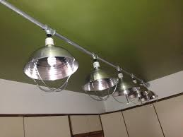 first stop remove the drop ceiling and make a custom light fixture