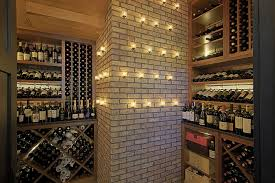 wine room furniture. simple interior home wine room design ideas with large wood brown cabinet furniture complete the shelving and neutral brick wall style