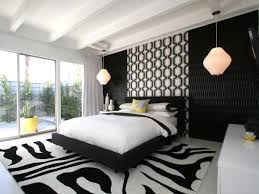 black and white midcentury style bedroom made lively with geometric prints