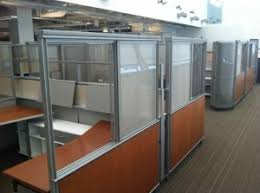 these cubicles are just plain beautiful to behold with curved glass walls genuine cherry wood panels and work surfaces and a sleek modern look and feel cheap office cubicles