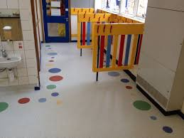 we installed tarasafe ultra sheet vinyl with diffe colours and size circles to create a border around their classroom and cloakroom