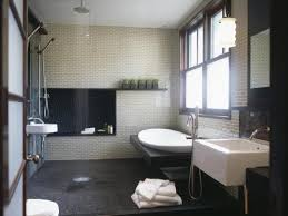 asian inspired spa bathroom with rain shower and freestanding tub