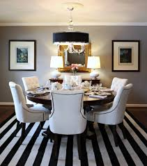 amusing design ideas using round brown wooden tables and dining room rectangular white black stripes rugs also with fabric armchairs amazing decorations