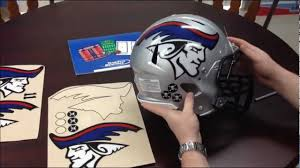 team fitz graphics applying oversized football helmet decals