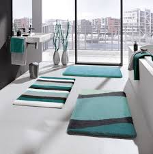 teal colored unique rug for modern bathroom ideas with nice glass wall tiles and perfect wall mounted sink