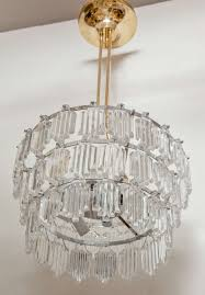 swedish modern three tier crystal chandelier suspended from a brass and nickel ar by orrefors