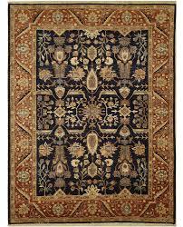 a tan and blue rug carpet available through david e adler inc