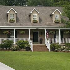 I love this front yard and the flowers hanging across the porch. Simple, not
