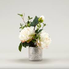 large white peonies in gold mercury glass vase
