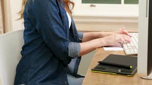 student preparing to write an essay book and laptop computer  smiling brunette using computer and digital board in office hd stock video clip