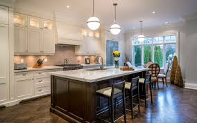 Dark wood floor kitchen Light Blue Large Bay Window Filters In Natural Light To This Stunning Kitchen The White Marble Home Stratosphere 34 Kitchens With Dark Wood Floors pictures