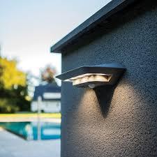 lutec ghost led solar wall light with pir sensor silver lighting direct